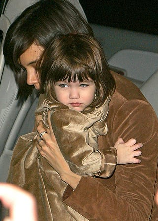 Illustration for article titled Suri Cruise Gives Photogs The Stink Eye