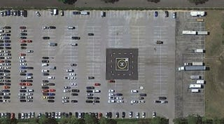 Illustration for article titled This parking lot has a helipad smack dab in the middle of it.