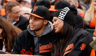 Steph Curry of the Golden State Warriors and his wife, Ayesha, watch the San Francisco Giants at AT&T Park in San Francisco on May 29, 2015.Lachlan Cunningham/Getty Images