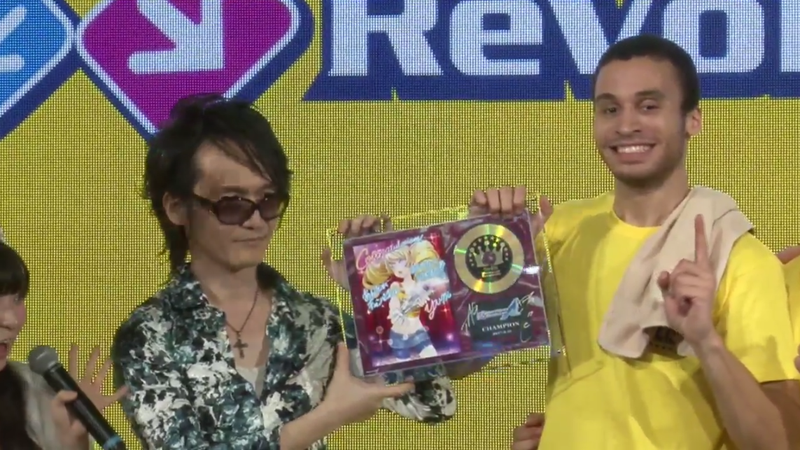 DDR's main composer, Yuichi Asami, presenting Chike with his trophy at the DDR World Championship.
