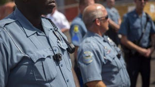 Members of the Ferguson Police Department wear body cameras during a rally Aug. 30, 2014, in Ferguson, Mo. Michael Brown, an unarmed 18-year-old, was shot and killed Aug. 9, 2014, by then-Ferguson Police Officer Darren Wilson. Aaron P. Bernstein/Getty Images