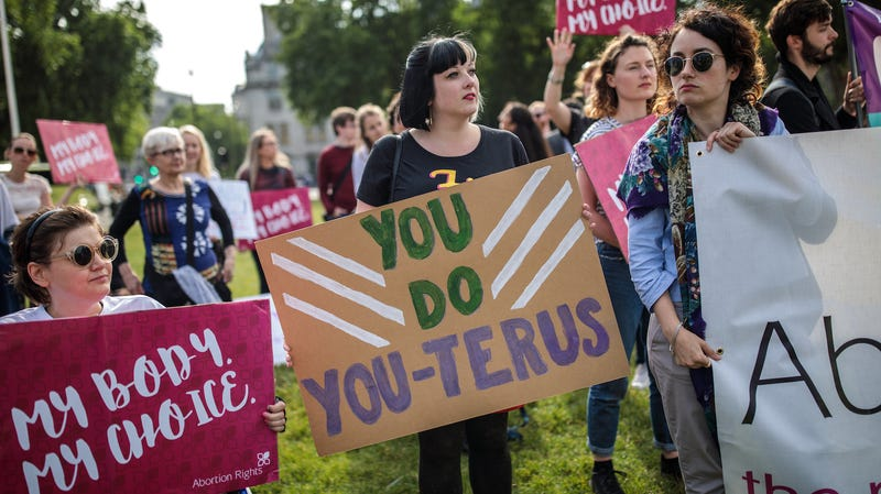 Pro-choice campaigners hold placards outside the Houses of Parliament during a demonstration to urge the Government to extend the same laws on abortion across the UK, including Northern Ireland on June 5, 2018 in London, England.