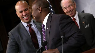 Sen. Cory Booker (D-N.J.) greets Sen. Tim Scott (R-S.C.) as Senate Judiciary Committee Chairman Sen. Chuck Grassley (R-Iowa) looks on during a press conference Oct. 1, 2015, at the U.S. Capitol announcing a bipartisan effort to reform the criminal-justice system.Win McNamee/Getty Images