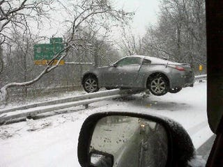 Illustration for article titled Nissan 350Z Teeters On Guard Rail After Snowy Crash