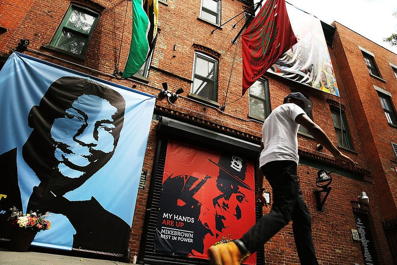 A memorial of Eric Garner, left, next to one of Michael Brown as seen outside of filmmaker's Spike Lee's 40 Acres offices on August 15, 2014, in Brooklyn, N.Y.