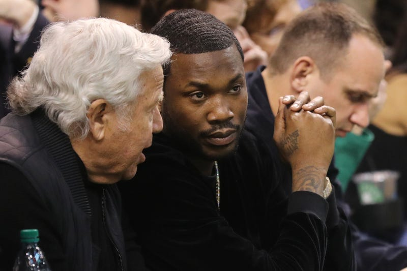 BOSTON, MA - Rapper Meek Mill talks with New England Patriots owner Robert Kraft during Game Two of the Eastern Conference Second Round of the 2018 NBA Playoffs between the Boston Celtics and the Philadelphia 76ers at TD Garden on May 3, 2018 in Boston, Massachusetts. The Celtics defeat the 76ers 108-103.