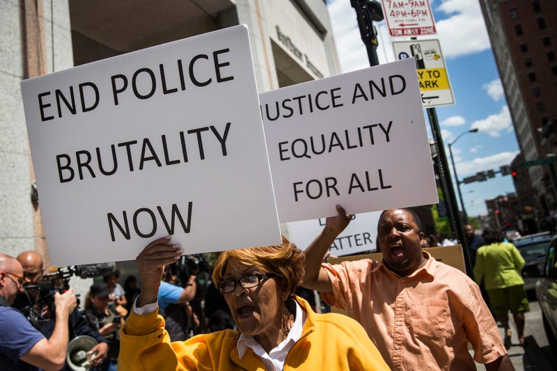 People rally for the family of Freddie Gray outside the Maryland State's Attorney's Office April 29, 2015, in Baltimore. Gray, 25, died from a severe spinal cord injury he received while in police custody. Andrew Burton/Getty Images