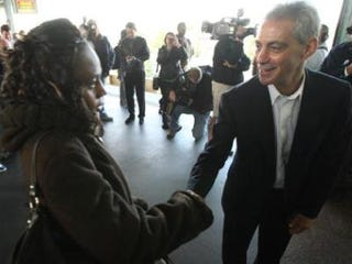 Rahm Emanuel greets a potential voter. (John Gress/Getty Images)
