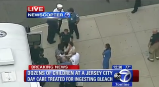 Children are escorted off a school bus upon arrival at a hospital after being sickened at a Jersey City, N.J., day care Sept. 11, 2014. WABCScreenshot