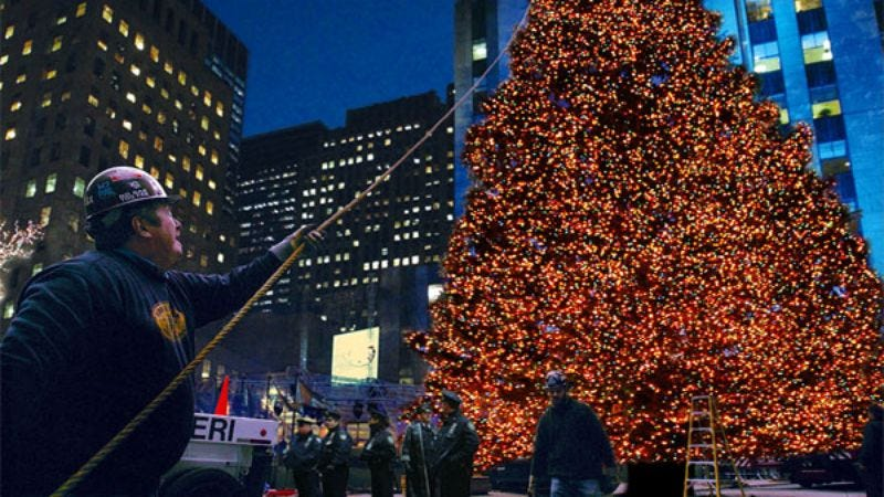 Per the court order, city workers take down the Christmas tree from New York's Rockefeller Plaza.