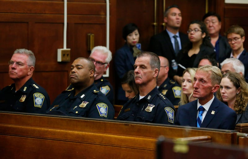Members of the Boston Police Department, including Police Commissioner William Evans (right) and Superintendent-in-Chief William Gross (second from left), listen to proceedings during a hearing over the issue of body cameras for Boston police officers at Suffolk Superior Court in Boston on Sept. 6, 2016. Jessica Rinaldi/The Boston Globe via Getty Images