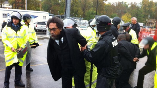 Cornel West as he was arrested during protests in Ferguson, Mo., Oct. 13, 2014Twitter