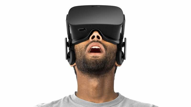 A bearded man goes slack-jawed with awe as he uses the Oculus Rift. (Photo: Oculus)
