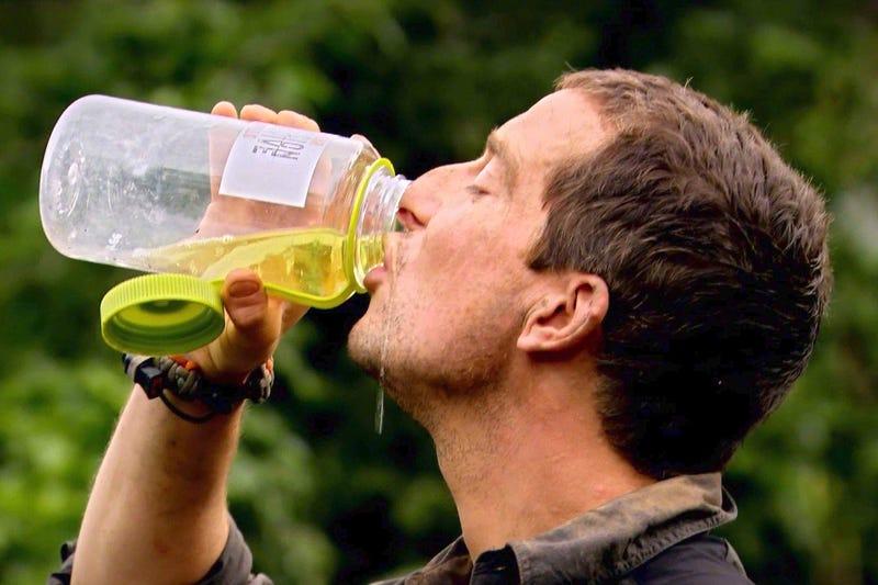Bear Grylls enjoying a mid afternoon sip of urine.