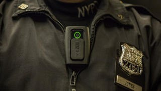 NYPD Officer Joshua Jones demonstrates how to use and operate a body camera during a press conference Dec. 3, 2014, in New York City.Andrew Burton/Getty Images