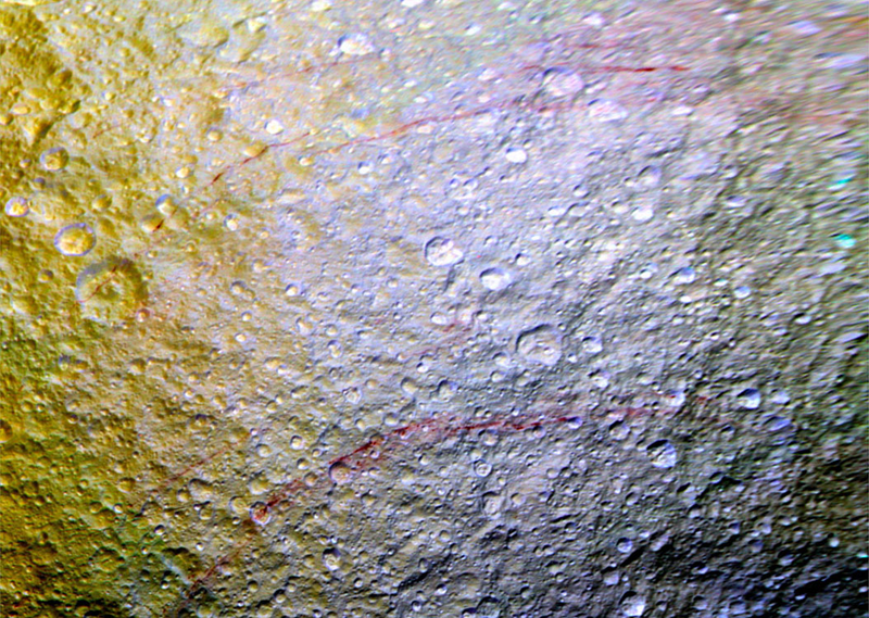 """Illustration for article titled Cassini Spies """"Unusual"""" Red Arcs on Saturn's Icy Moon Tethys"""