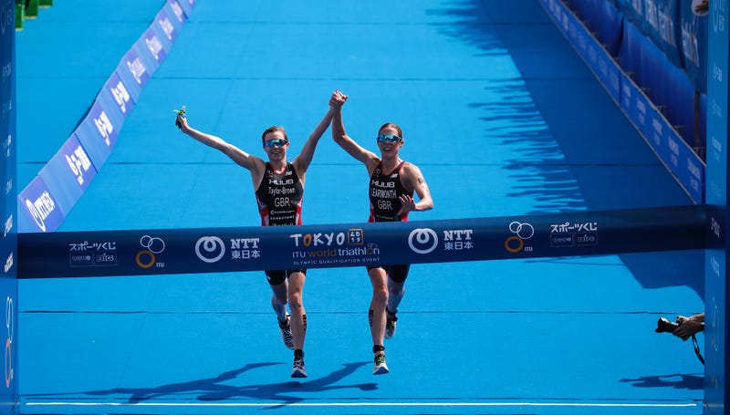 Illustration for article titled Winning Triathletes DQ'd From Olympic Test Event For Crossing Finish Line Hand-In-Hand