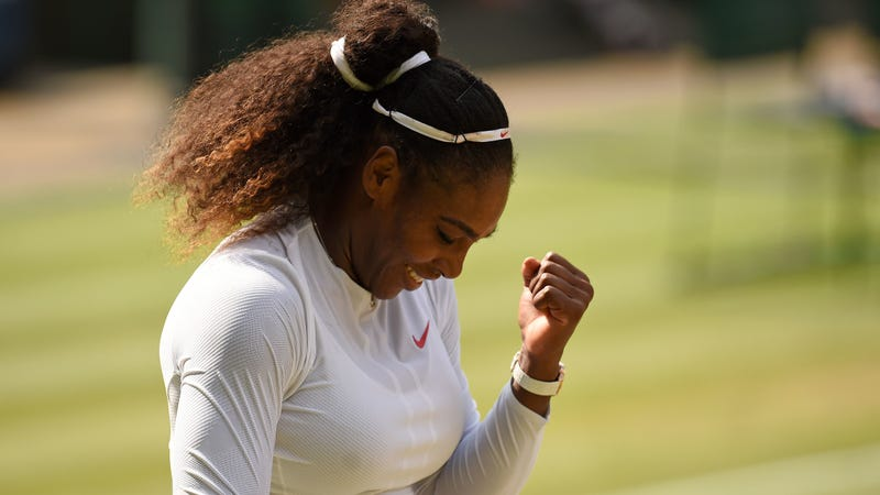 Serena Williams celebrates after beating Germany's Julia Goerges at The All England Lawn Tennis Club in Wimbledon on July 12, 2018.
