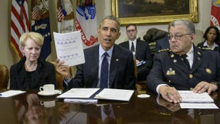 Laurie Robinson, professor of criminology at George Mason University, and Philadelphia Police Commissioner Charles H. Ramsey flank President Barack Obama as he talks about a report of law-enforcement recommendations during a press conference at the White House March 2, 2015.BRENDAN SMIALOWSKI/Getty Images