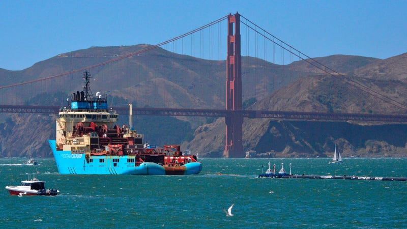 Ocean Cleanup's massive plastic-collecting boom being towed out to sea on September 8th, 2018.