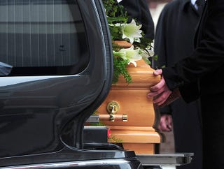 Illustration for article titled Pallbearers Carry Leslie Nielsen's Coffin Without Incident