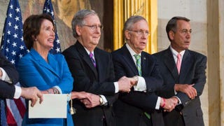 """House Minority Leader Nancy Pelosi (D-Calif.), Senate Minority Leader Mitch McConnell (R-Ky.), Senate Majority Leader Harry Reid (D-Nev.) and Speaker of the House John Boehner (R-Ohio) lock arms as they sing """"We Shall Overcome"""" during a ceremony to posthumously award the Congressional Gold Medal to Martin Luther King Jr. and Coretta Scott King on Capitol Hill June 24, 2014, in Washington, D.C.Drew Angerer/Getty Images"""