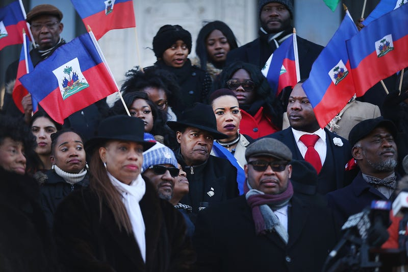 Waving the national flag of Haiti, students, activists and area politicians attend a unity rally on the steps of City Hall in downtown Newark, N.J., in support of immigrants on Jan. 18, 2018. (Spencer Platt/Getty Images)