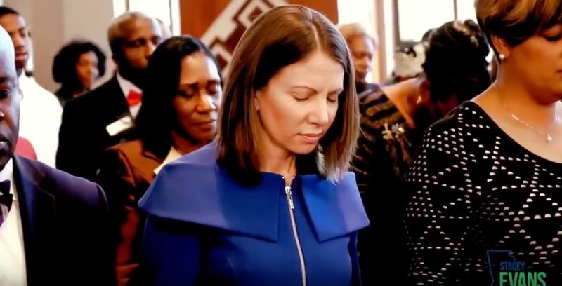Former Georgia state Rep. Stacey Evans praying inside Ebenezer Baptist Church (eoin higgins via YouTube screenshot)