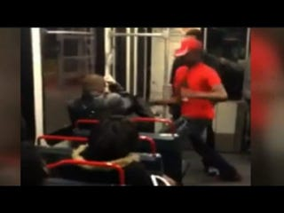 A St. Louis train rider is attacked over his response to a question about the shooting death of Michael Brown in Ferguson, Mo., last August.YouTube Screenshot