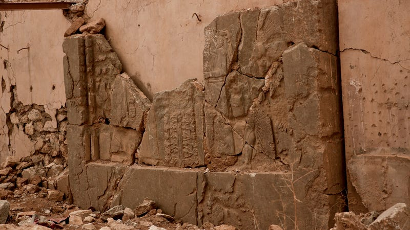 An ancient relief lies shattered in the Northwest Palace at the nearly 3,000-year-old site of Nimrud, Iraq. Photo via AP Images.