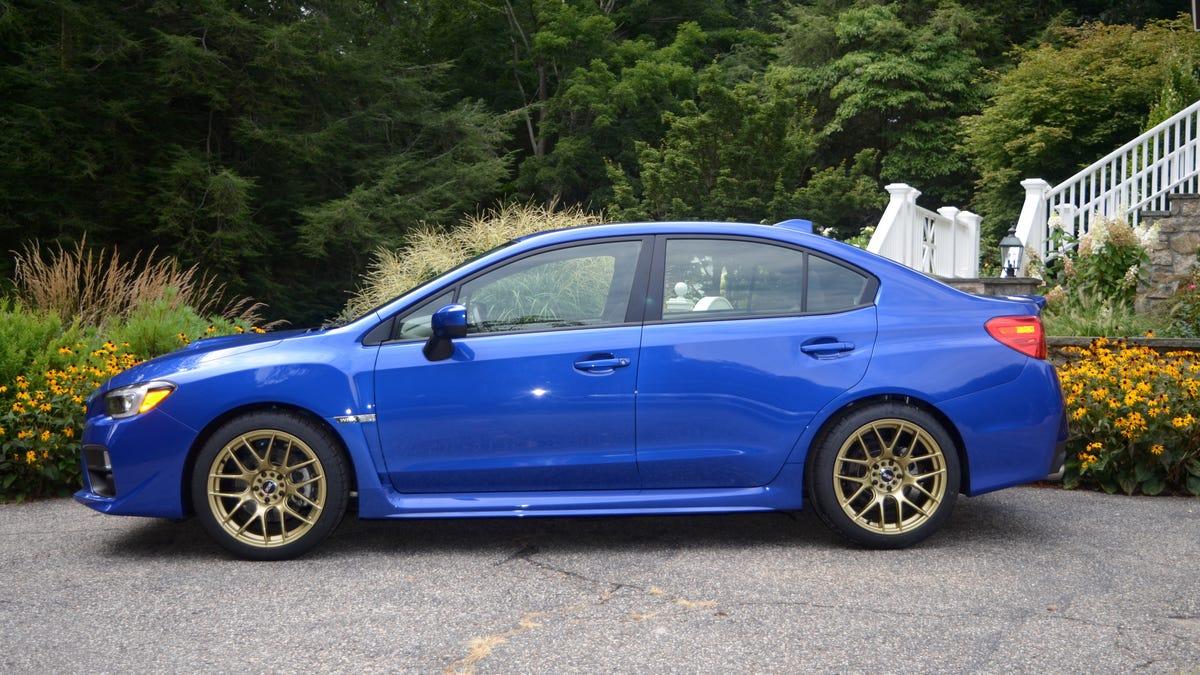World Rally Blue With Gold Wheels Sti White Rims