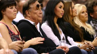 LA Clippers owner Donald Sterling and V. Stiviano watch the San Antonio Spurs play against the Memphis Grizzlies during Game 1 of the Western Conference Finals of the 2013 NBA Playoffs at AT&T Center on May 19, 2013 in San Antonio, Texas.Ronald Martinez/Getty Images