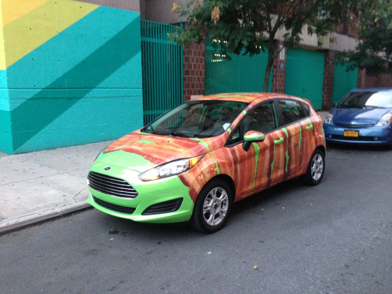 Illustration for article titled Bacon-Wrapped Ford Is Nothing More Than Brilliant PR And I Don't Care
