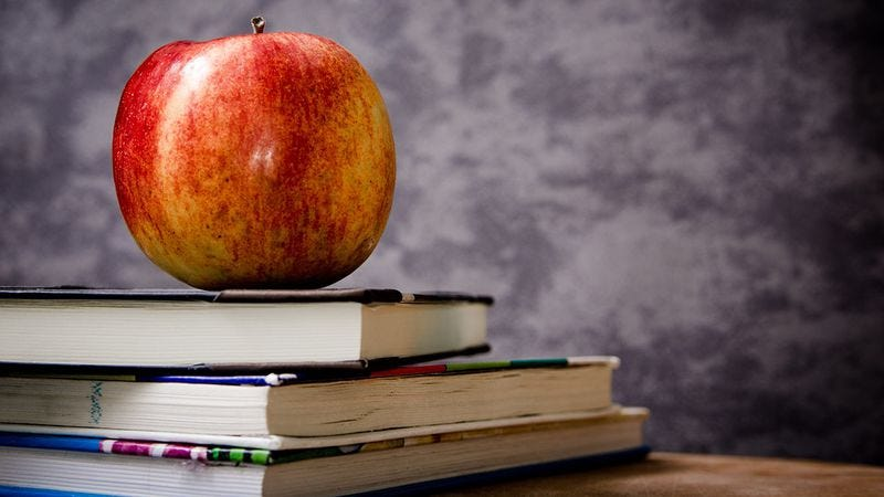 Why do we give an apple to the teacher?