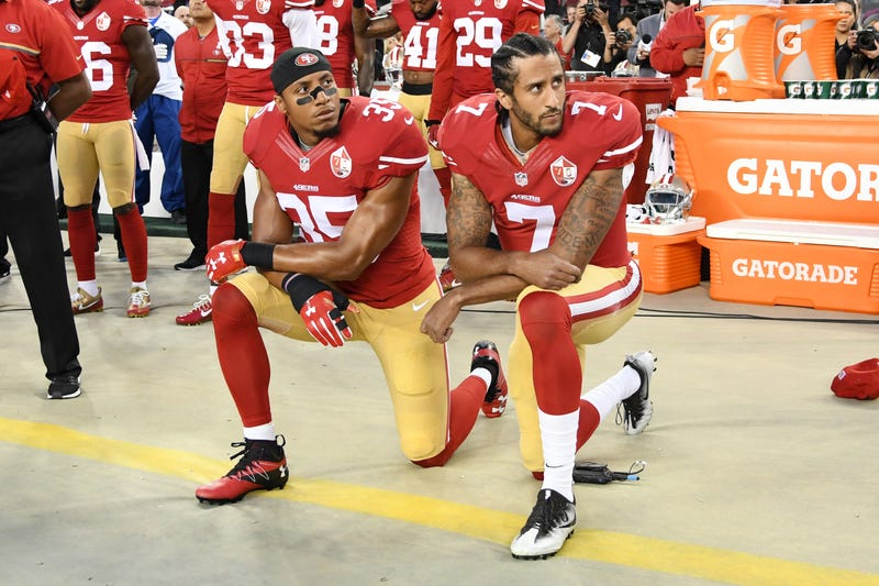 San Francisco 49ers safety Eric Reid kneels next to quarterback Colin Kaepernick during the national anthem prior to playing the Los Angeles Rams in their NFL game at Levi's Stadium on Sept. 12, 2016, in Santa Clara, Calif.