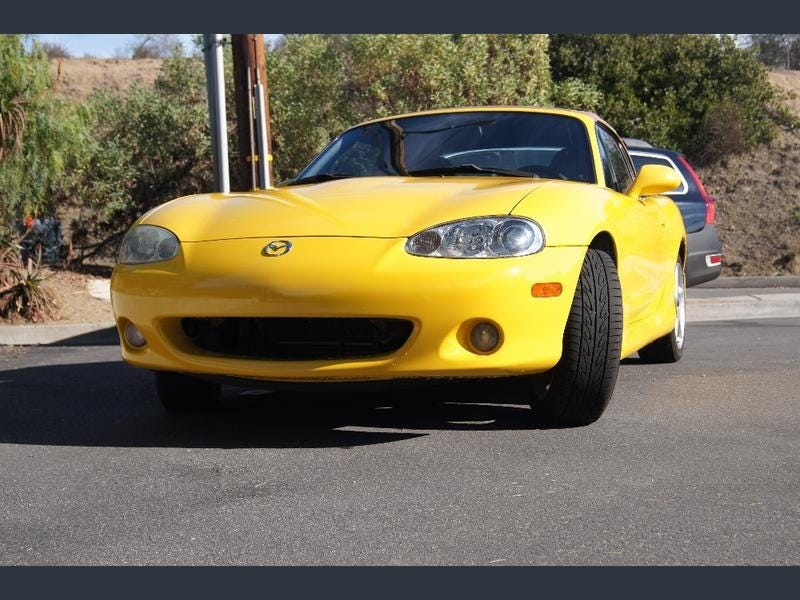 Illustration for article titled I'm Obsessed with Yellow Miatas