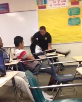 Video footage of now-fired Sheriff's Deputy Ben Fields manhandling a student at Spring Valley High School in Columbia, S.C., where he worked as a school resource officerYouTube screenshot