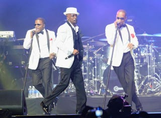 Ricky Bell, Ralph Tresvant and Ronnie Devoe perform onstage with New Edition at the 2013 BET Experience event at the Staples Center in Los Angeles June 30, 2013.Earl Gibson III/Getty Images for BET