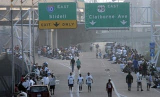 Ten years ago, people wandered along Interstate 10 near the New Orleans Superdome to escape Hurricane Katrina. Amid dire predictions, authorities decided to try to empty the city and move residents from the Superdome to shelters in Dallas and Houston in a two-day caravan of buses.Irwin Thompson/Dallas Morning News