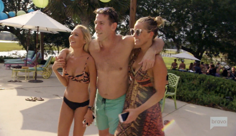 Failed libertarian politician Thomas Ravenel clings to a pair of 24-year-olds at a pool party. Screenshot via Bravo.