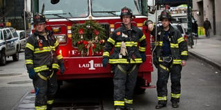 Three FDNY firefighters responding to a fire on Dec. 26, 2012 (Andrew Burton/Getty Images)