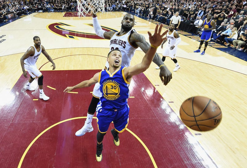 Stephen Curry, No. 30 of the Golden State Warriors, has his shot blocked by LeBron James, No. 23 of the Cleveland Cavaliers, during the second half of Game 6 of the 2016 NBA Finals June 16, 2016, in Cleveland.Bob Donnan/Pool/Getty Images