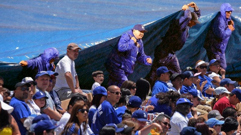 Illustration for article titled Dodgers Grounds Crew Places Tarp Over Unsightly Crowd