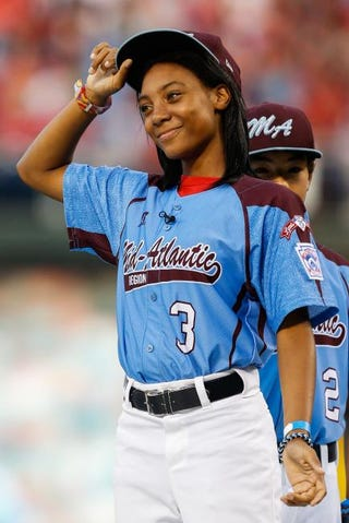 Mo'ne Davis tips her hat as she is introduced and recognized before the game between the Washington Nationals and the Philadelphia Phillies at Citizens Bank Park on Aug. 27, 2014, in Philadelphia.Brian Garfinkel/Getty Images