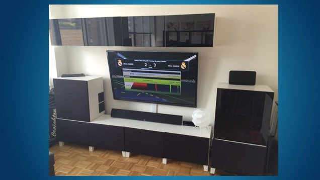 using besta shelves and cleverly used speaker fabric in place of solid
