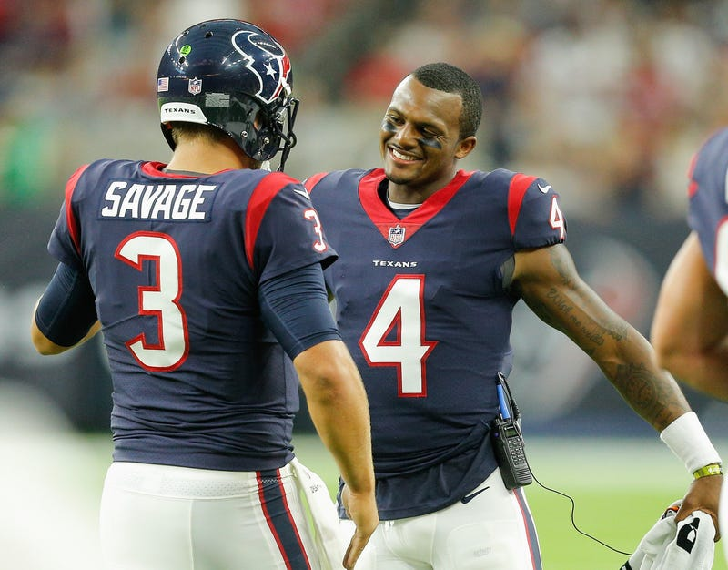 Tom Savage, No. 3 of the Houston Texans, is congratulated by Deshaun Watson, No. 4, after throwing a touchdown pass in the first quarter at NRG Stadium  in Houston on Aug. 19, 2017. (Bob Levey/Getty Images)