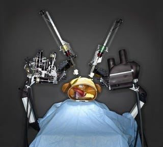Illustration for article titled Robot Surgeons to put Human Docs out of Work