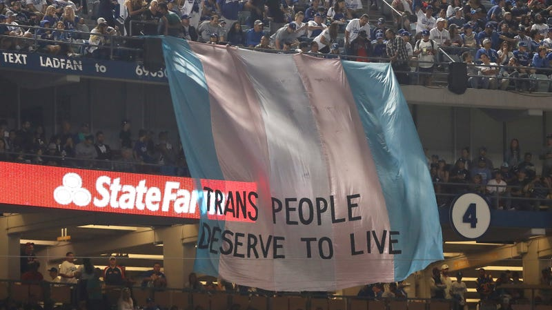 "Illustration for article titled Activists Display Huge ""Trans People Deserve To Live"" Banner During World Series"