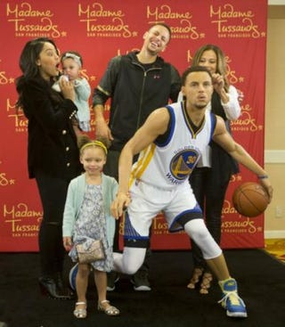 Stephen Curry and family with his wax figureTwitter