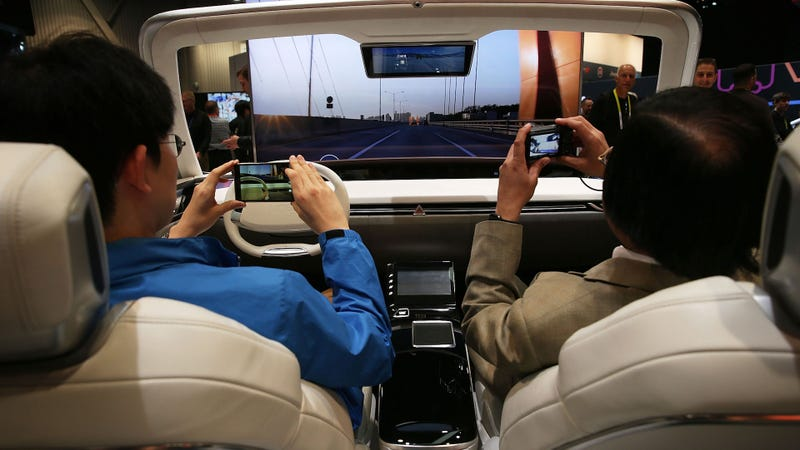 Visitors in a simulator of future self-driving cars at CES in 2016. Photo credit: Alex Wong/Getty Images